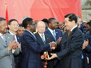 Jia Qinglin (R, front), chairman of the National Committee of the Chinese People's Political Consultative Conference, hands over the golden key which represents the new Conference Center for the African Union (AU) to Equatorial Guinean President and AU Ch