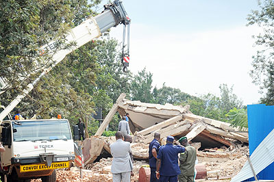 A rescue operation at the Petit Meridien building, which collapsed on Tuesday, killing one person.  The New Times File.