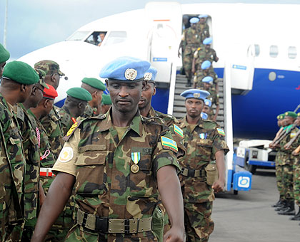 Rwandan peacekeepers upon arrival at Kigali International Airport, recently, from Darfur, where the country is involved in another UN-backed mission. The New Times / File.