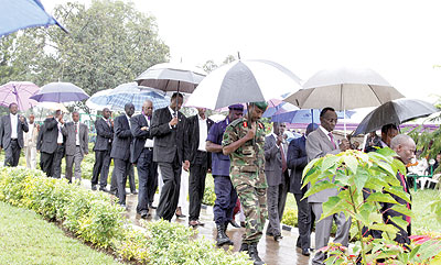 Senior officials move to lay wreaths on the graves of the fallen politicians.