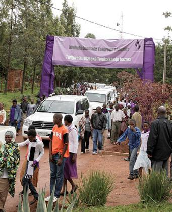 Mourners who had attended the closure of the one-week commemoration leave Rebero Memorial Centre.