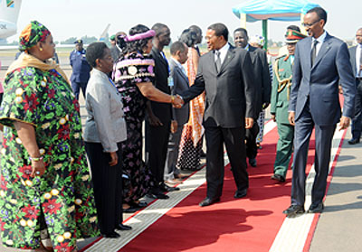 Tanzanian President Jakaya Kikwete greets members of the Tanzanian delegation at Kigali International Airport. Looking on is President Kagame.