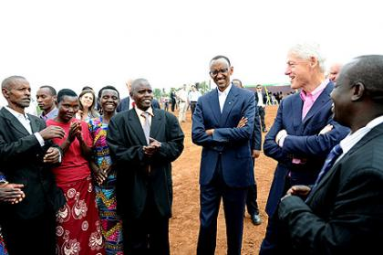 President Kagame and President Clinton speaking with soy farmers at Mt. Meru Soyco Plant. Kayonza, 19 July 2012