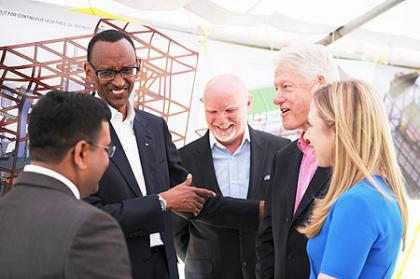Vice Chairman of Mt.Seru Soyco Plant Arvin Patel with President Clinton and Chelsea Clinton. Kayonza, 19 July 2012