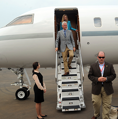President Bill Clinton on his arrival at Kigali International Airport on Wednesday.