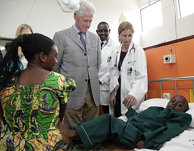 President Clinton visits one of the cancer patients at the Butaro Hospital where he inaugurated a cancer centre of excellence on Wednesday..