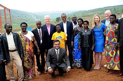 Presidents Kagame and Clinton, Chelsea Clinton, Vice Chairman of Mt. Meru Soyco factory Arvind Patel and soy farmers in Kayonza District on Thursday.