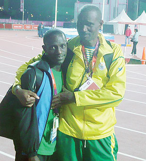 Robert Kajuga and his coach Innocent Rwabuhihi after competing in the 10,000m at the London Games. The New Times/Courtesy.