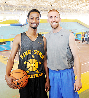 Lionel Hakizimana (L) and Los Angeles Lakers' Point Guard Steve Blake. The New Times/J. Mbanda.