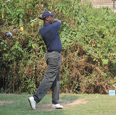 Louis Kamanzi  looking in the direction of the ball after taking a short on the second hole yesterday.  The Sunday Times / John Mbanda.