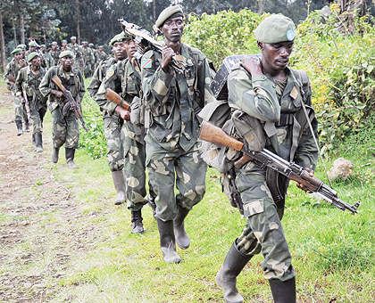 RDF Special Forces in Congolese army fatigues, returning home from DRC's volatile Rutchuru region, where they were conducting joint operations with FARDC. The New Times / File.