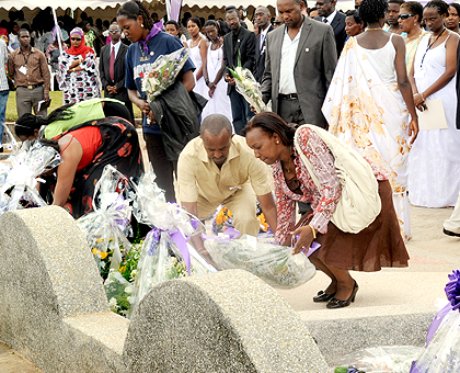 Some of the family members and officials lay wreaths on the graves of politicians killed during the 1994 Genocide, at their cemetery on Rebero Hill. The New Times / File.