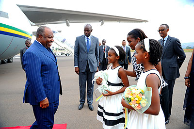 Children welcoming President Ali Bongo at Kigali International Airport last Friday.