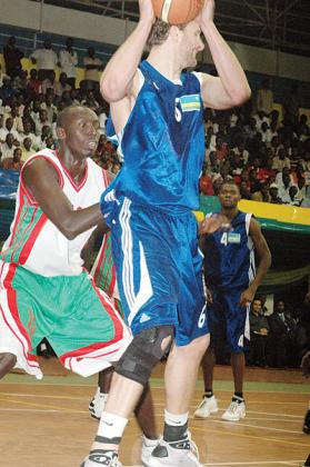 Thompson, seen here in action against Burundi during the 2009 Zone V championships held in Kigali, says is opposed to the idea of using many 'foreigners'. The New Times/File.