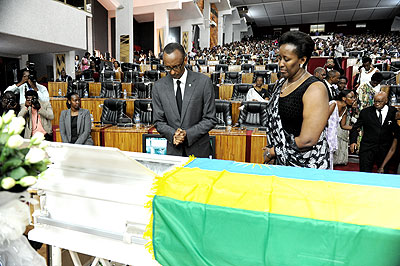 President Paul Kagame and the First Lady Jeanette pay their last respects to the late Gender and Family Promotion minister Aloisea Inyumba at Parliament yesterday.