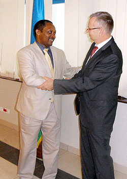 Prof. Shyaka, CEO, RGB (L) and  Andreas Proksch, GIZ Director for Africa. The New Times  / Jean de la Croix Tabaro.