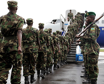 RDF soldiers board a Darfur-bound RwandAir Plane at Kigali International Air port in the past. The New Times / T.Kisambira.