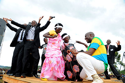 Elderly women of Nyamasheke join artistes on stage before President Kagame's visit to the district.