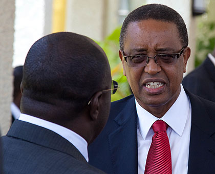 The incoming Infrastructure Minister Prof. Lwakabamba (R), chats with Prime Minister Dr. Pierre Damien Habumuremyi at Parliament yesterday.  The New Times/Timothy Kisambira.