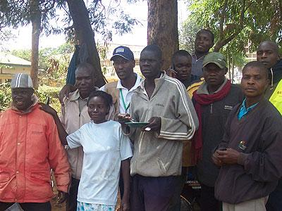 The writer (4th from left) poses for a picture with locals of Kitale.