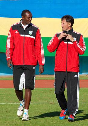 Micho (left) and his assistant Eric Nshimiyimana taking to the field for the second half of Wednesday's friendly match against Libya. Saturday Sport / T. Kisambira.