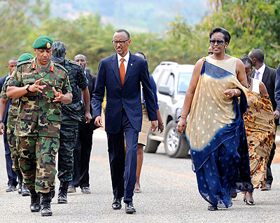 President Kagame and First Lady Jeannette Kagame arrive at Kami Barracks, Kinyinya Sector in Gasabo District to celebrate  the19th Liberation Day yesterday. Accompanying President Kagame is Chief of Defence Staff, Gen. Patrick Nyamvumba (L)  and other government officials.
