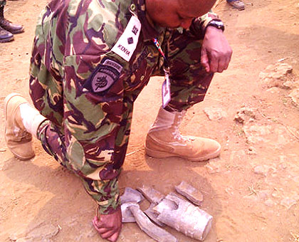 A member of the ICGLR monitors inspects components of the mortar bomb that was fired into Rubavu in Western Rwanda from DR Congo side on Monday. The New Times/Courtesy