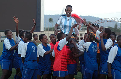 AS Kigali coach Grace Nyinawumuntu is carried shoulder high by her players after winning the league last year.  The New Times / File.