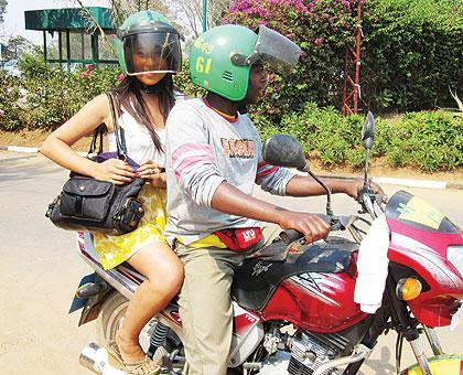 Even though passengers don't seem comfortable with the arrangement of having to don helmets that are worn by other people, few ever complain. Sunday Times/Internet photo
