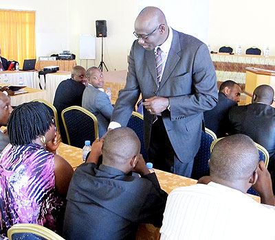 Minister  Busingye interacts with some judges during a previous  meeting in Kigali.  The New Times/ file.