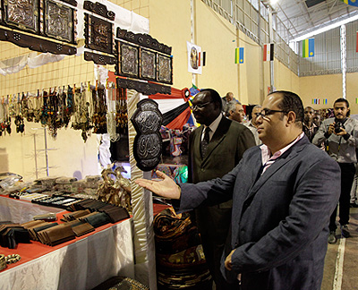 Minister Kanimba tours a stall at the Egypt Expo in Kigali on Wednesday.   Saturday Times/Timothy Kisambira.