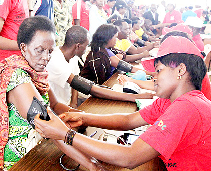 An elderly woman checks for high blood pressure during the tests at the launch of the campaign against non-communicable diseases at Petit Stade in Remera.The New Times/ John Mbanda.