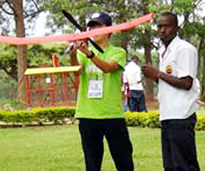 Students attempt to fly a model plane during the competition. The New Times/ S. Babijja