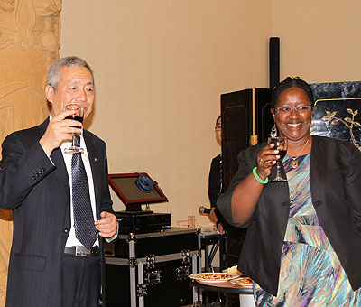The Chinese ambassador to Rwanda Shen Yong-Xiang and Health Minister Binagwaho toast to the Rwanda-China cooperation on Monday. The New Times/Susan Babijja