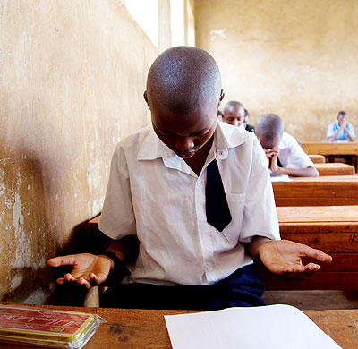 PRAYER FIRST: A pupil prays in the examinations room before the start of the exams.