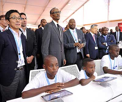President Kagame and other delegates during an ICT demonstration yesterday.