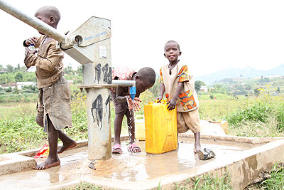 Children draw water at a borehole in a village in Karongi District. The New Times/ File.