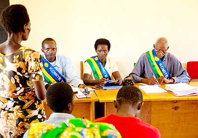 Local mediators hear a case. New law reform seeks to give the Abunzi more mandate. The New Times/ File.