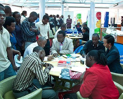 Graduates talk to different companies during last years Job Day. The New Times/Timothy Kisambira