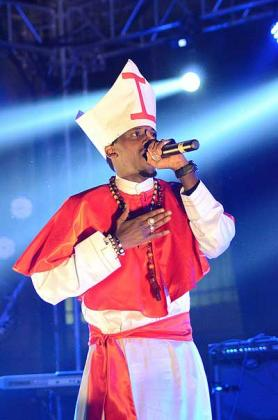 The rapper appeared on stage dressed like a pope.