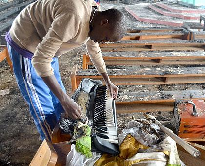 A student sifting through the remains inside a gutted chapel at ES Byimana. Officials at at the School say that they have installed CCTV to improve security. Sunday Times/File