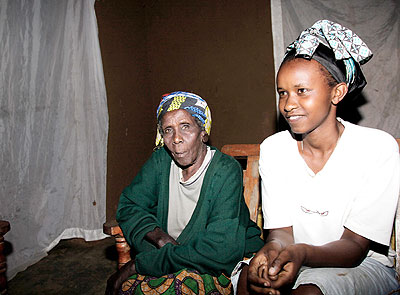 Nyiragakara (L) with grand daughter Twahirwa during the interview with this paper.   The New Times/ John Mbanda.