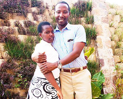Vedaste Karenzi congratulates his daughter Annie Christella Ihoza of Kigali Parents, who scored 5 points. The New Times/ Timothy Kisambira.