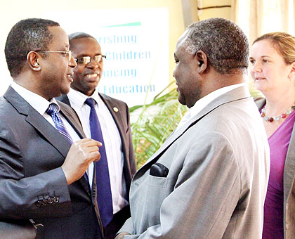 From L-R; Education minister Vincent Biruta, State minister for Primary and Secondary Education Mathias Harebamungu, Prof. George Njoroge, the principal of College of Education, and Unicef's Noala Skinner chat after the meeting yesterday. John Mbanda.