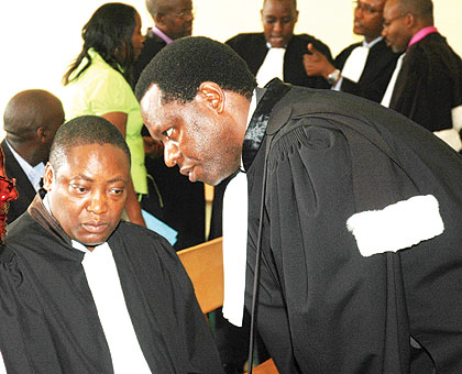 Advocates consult in court during a past hearing. Some activists have questioned the rationale of increasing the court fees. File.