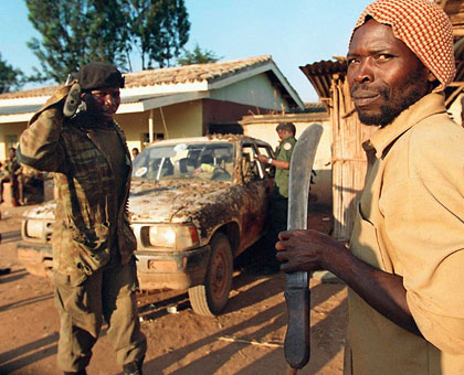 Members of the Interahamwe militia during the 1994 Genocide against the Tutsi. The Habyarimana regime enlisted the services of many civilians in preparation for the Genocide.  Net photo.