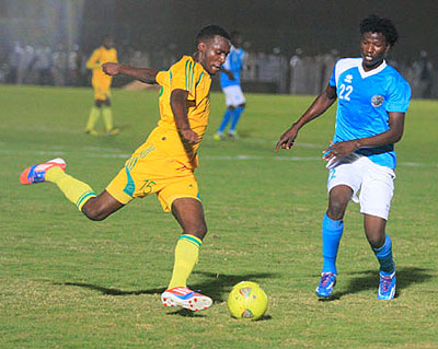 Defender Soter Kayumba, left, seen here challenging an Al Ahly Shendi striker, scored the winning penalty to help AS Kigali win 5-4 after a 1-all aggregate draw in the first round ....