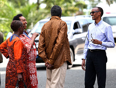 President Paul Kagame shares a light moment with some of the officials at the 11th National Leadership Retreat.