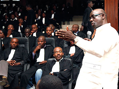 Justice minister Busingye gives a presentation during a meeting of lawyers at the Supreme Court on September 15, 2011. (File)