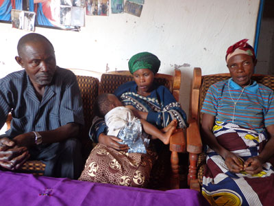 Yankurije (C), her mother-in-law (R) and father during the interview. The families exemplify the ideals of reconciliation. (Jean de la Croix Tabaro)